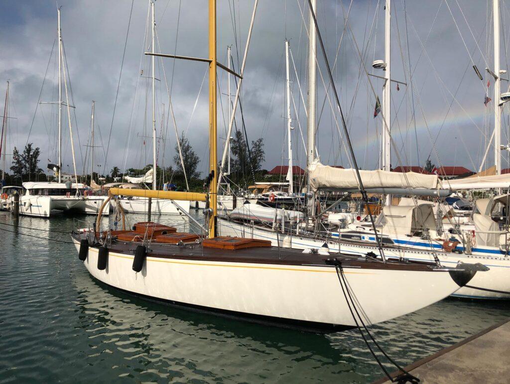 docked boats with a rainbow