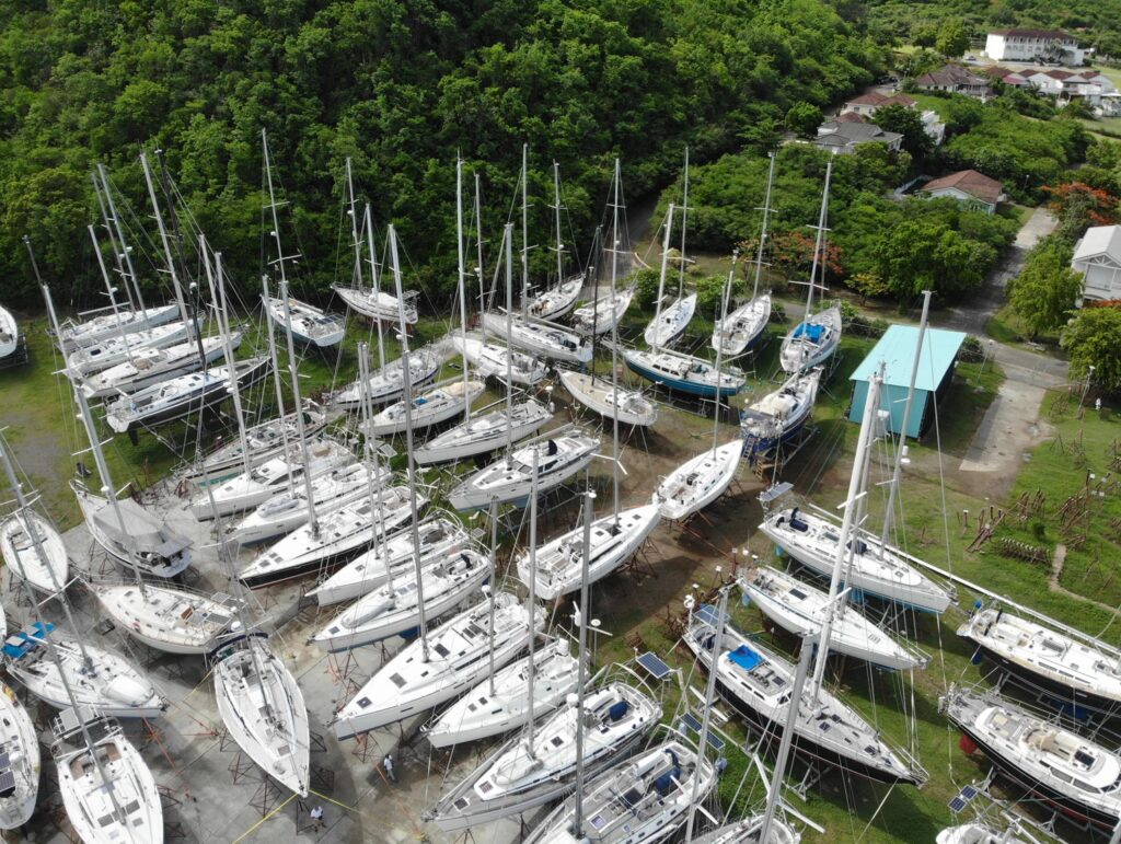 many boats in the yard on lifts