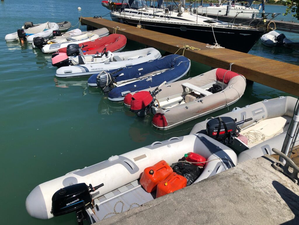 multicolored dinghies by the dock