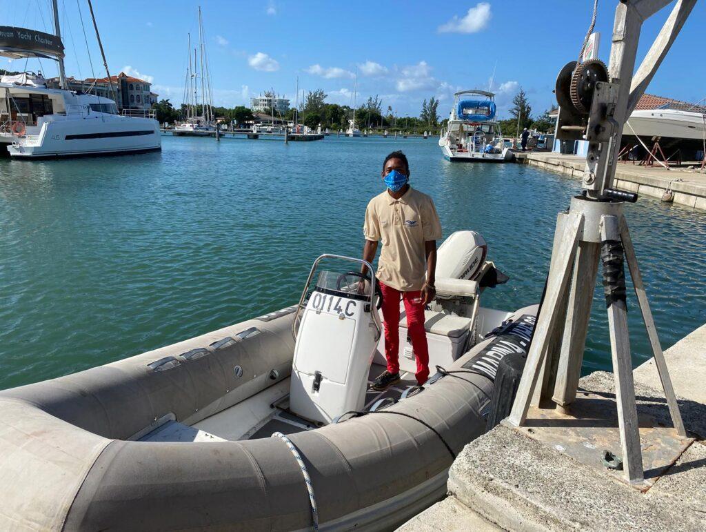 Dock team member Rasheem on his vessel