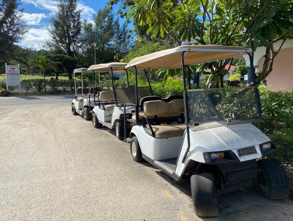 a line of golf carts